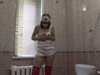Youthfull nurse pokes her caboose faux-cock in the bathroom. HD Thumb