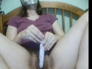 A Hooded Masturbator Fiddles Her Unshaved Pubic Hair Thumb